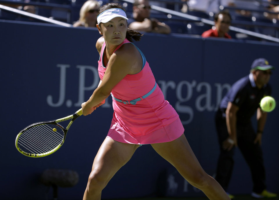 Photo - Shuai Peng, of China, returns a shot against Roberta Vinci, of Italy, during the third round  of the 2014 U.S. Open tennis tournament, Friday, Aug. 29, 2014, in New York. (AP Photo/Frank Franklin II)