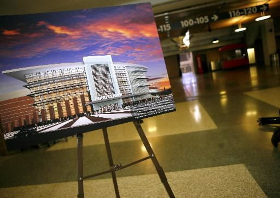 An artist's rendering of what the  Ford  Center will look like in 2010 sits in the lobby during a tour of the  Ford  Center's improvements in downtown Oklahoma City on Sunday, Oct. 11, 2009. By John Clanton