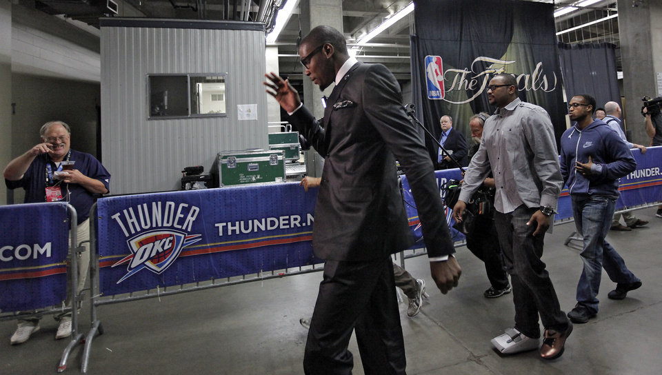 Oklahoma\'s Kevin Durant waves as he walks into the arena before the start of Game 1 of the NBA Finals between the Oklahoma City Thunder and the Miami Heat at Chesapeake Energy Arena in Oklahoma City, Tuesday, June 12, 2012. Photo by Chris Landsberger, The Oklahoman