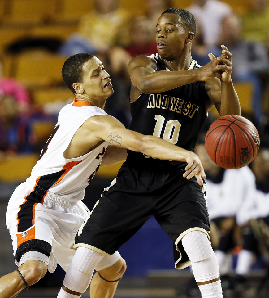Putnam City's David Bush (4) knocks the ball away from Midwest City's Torey Neal (10) during a Class 6A boys high school basketball game in the semifinals of the state tournament at the Mabee Center in Tulsa, Okla., Friday, March 8, 2013. Midwest City beat Putnam City, 57-50. Photo by Nate Billings, The Oklahoman
