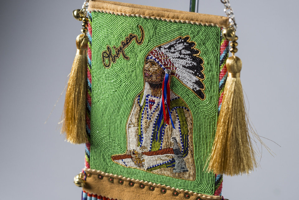 ?Looking Forward, Looking Back-Mirror Bag,? beadwork/quillwork, by Orlando Dugi and Kenneth Williams was selected Best of Show during the seventh annual Cherokee Art Market awards reception with $75,000 in overallprize money awarded across 20 categories held on Friday, Oct. 12, 2012, at Hard Rock Hotel & Casino Tulsa in Catoosa, Okla. The Cherokee Art Market features more than 130 elite Native American artists from across the nation. The finest Native American artwork representing more than 45 different tribes is on display and sale, including beadwork, pottery, painting, basketry, sculptures and textiles. Jeremy Charles