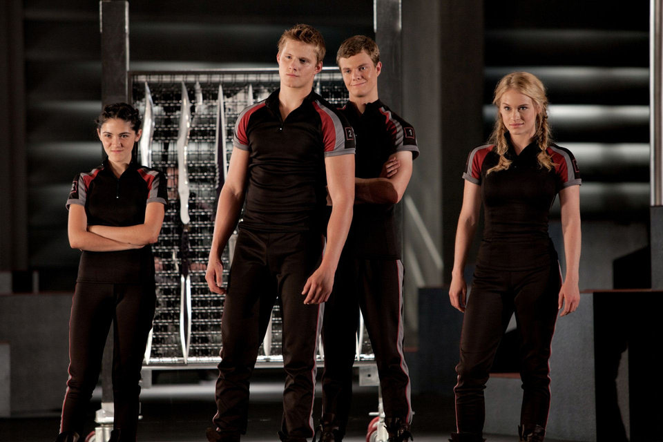 "Some of the ""tributes"" train in ""The Hunger Games."" From left to right: Clove (Isabelle Fuhrman), Cato (Alexander Ludwig), Marvel (Jack Quaid) and Glimmer (Leven Rambin). PHOTO BY MURRAY CLOSE PROVIDED. <strong>Photo credit: Murray Close</strong>"