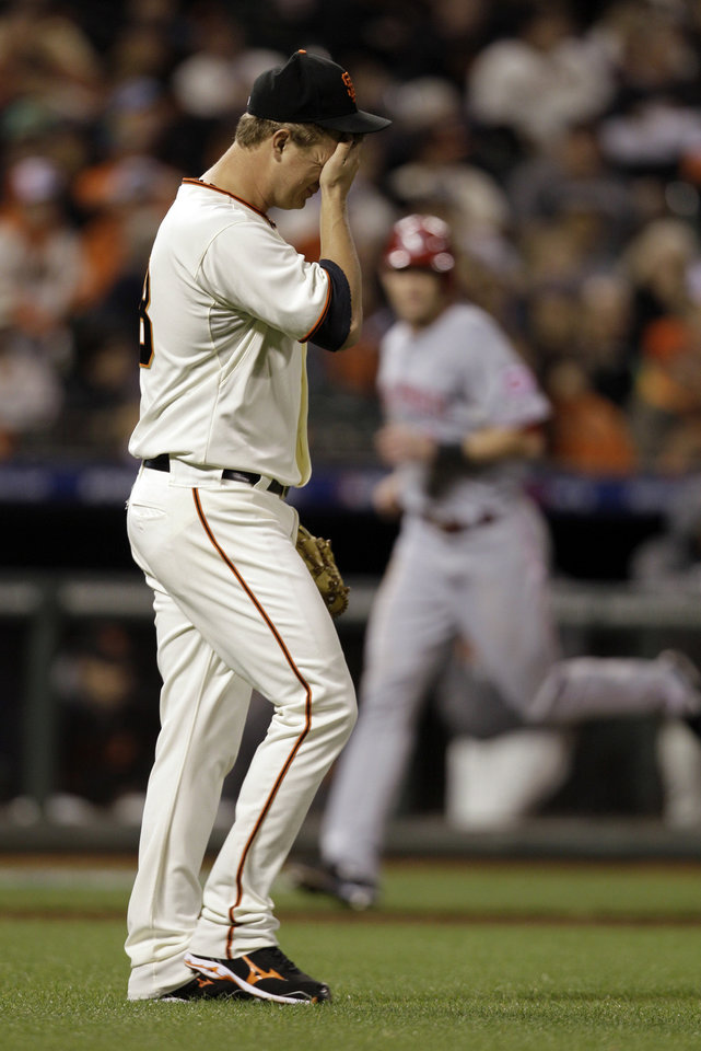 San Francisco Giants pitcher Matt Cain reacts after giving up a two-run home home to Cincinnati Reds\' Brandon Phillips in the third inning of Game 1 of the National League division baseball series in San Francisco, Saturday, Oct. 6, 2012. (AP Photo/Eric Risberg)