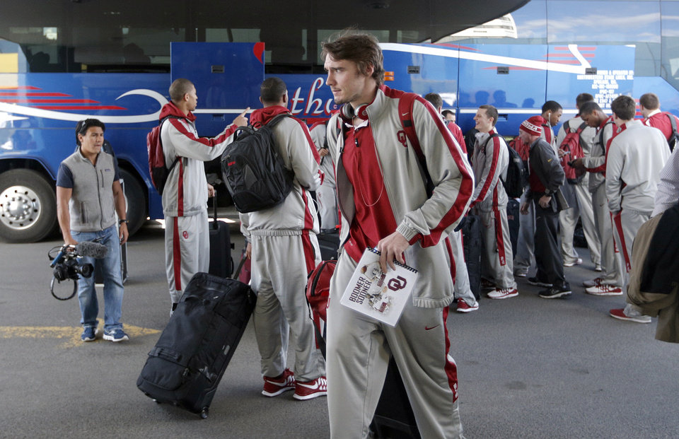Photo - Oklahoma's Ryan Spangler arrives at the team hotel in Spokane, Wash., for the men's NCAA basketball championship tournament, Tuesday, March 18, 2014.Photo by Sarah Phipps, The Oklahoman