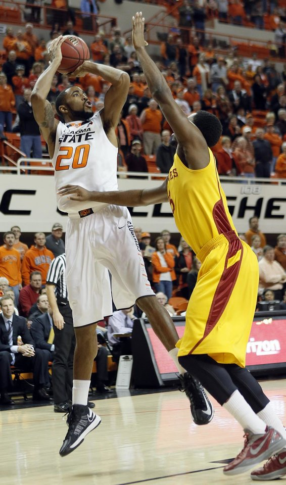 Photo - Oklahoma State Cowboys' Michael Cobbins (20) shoots over Iowa State Cyclones' Tyler Ellerman (33) during the college basketball game between the Oklahoma State University Cowboys (OSU) and the Iowa State University Cyclones (ISU) at Gallagher-Iba Arena on Wednesday, Jan. 30, 2013, in Stillwater, Okla.  Photo by Chris Landsberger, The Oklahoman