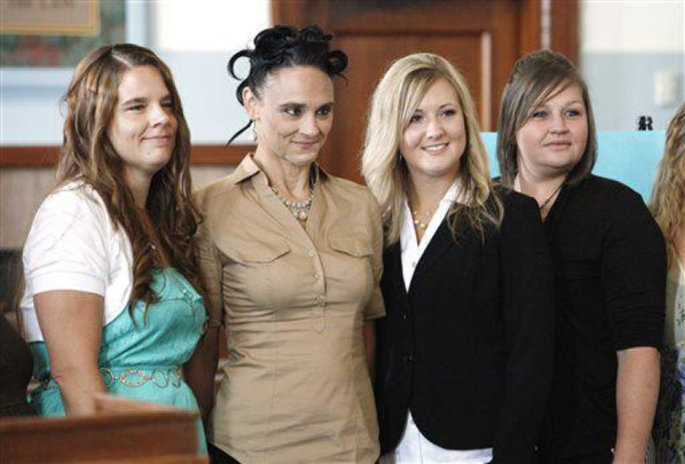 Graduates Chrystal Kinsey, Moore, Jamie Goodin, Oklahoma City, Bridgette Brown, Oklahoma City, and Carrie Slaughter, Oklahoma City, pose for photos during the ReMerge graduation ceremonies at the Oklahoma County Courthouse in Oklahoma City on Tuesday. The ReMerge program is an alternative to prison for mothers and pregnant women who are facing charges for nonviolent crimes. The Oklahoman, Paul B. Southerland <strong>PAUL B. SOUTHERLAND</strong>