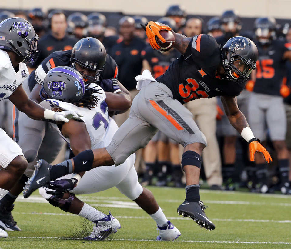 Photo - Oklahoma State's' Chris Carson (32) takes off for the end zone during the college football game between the Oklahoma State Cowboys (OSU) and the Central Arkansas Bears at Boone Pickens Stadium in Stillwater, Okla., Saturday, Sept. 12, 2015. Photo by Steve Sisney, The Oklahoman