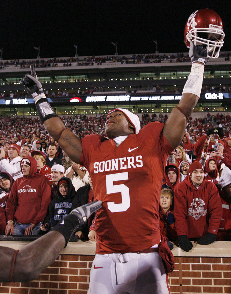 Photo - OU's Nic Harris celebrates after the college football game between the University of Oklahoma Sooners and Texas Tech University at Gaylord Family -- Oklahoma Memorial Stadium in Norman, Okla., Saturday, Nov. 22, 2008. OU won, 65-21. BY NATE BILLINGS, THE OKLAHOMAN