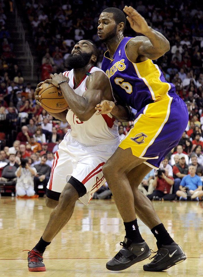 Houston Rockets' James Harden (13) is fouled by Los Angeles Lakers' Earl Clark (6) in the second half of an NBA basketball game, Tuesday, Dec. 4, 2012, in Houston. (AP Photo/Pat Sullivan)
