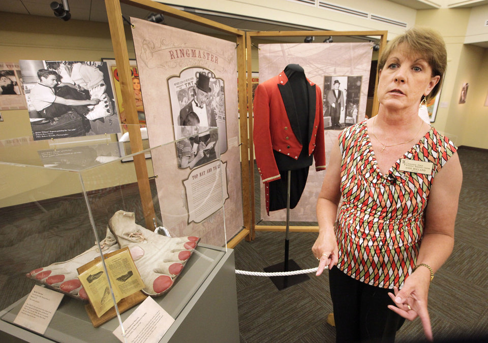 "Andi Holland, director of the Cherokee Strip Regional Heritage Center in Enid is shown at the exhibit ""Step Right Up! Behind the Scenes of the Circus Big Top, 1890-1965."" <strong>David McDaniel - The Oklahoman</strong>"