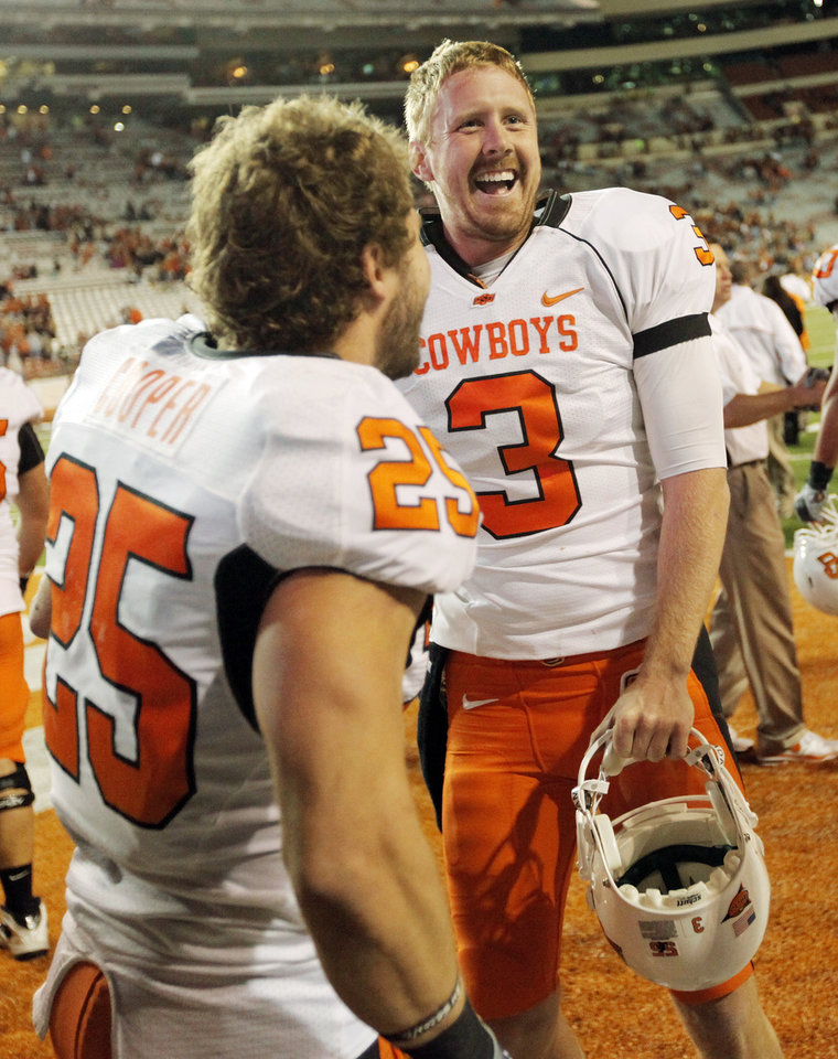 Photo - OSU quarterback Brandon Weeden (3) celebrates with Josh Cooper (25) after the college football game between the Oklahoma State University Cowboys (OSU) and the University of Texas Longhorns (UT) at Darrell K Royal-Texas Memorial Stadium in Austin, Texas, Saturday, November 13, 2010. OSU won, 33-16. Photo by Nate Billings, The Oklahoman