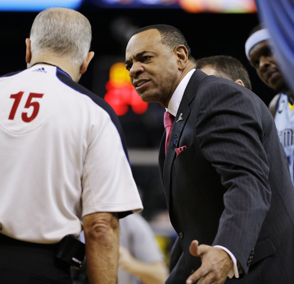 Memphis Grizzlies coach Lionel Hollins, right, speaks with referee Bennett Salvatore (15) during the first half of an NBA basketball game against the Golden State Warriors, Wednesday, Jan. 9, 2013, in Oakland, Calif. (AP Photo/Ben Margot)