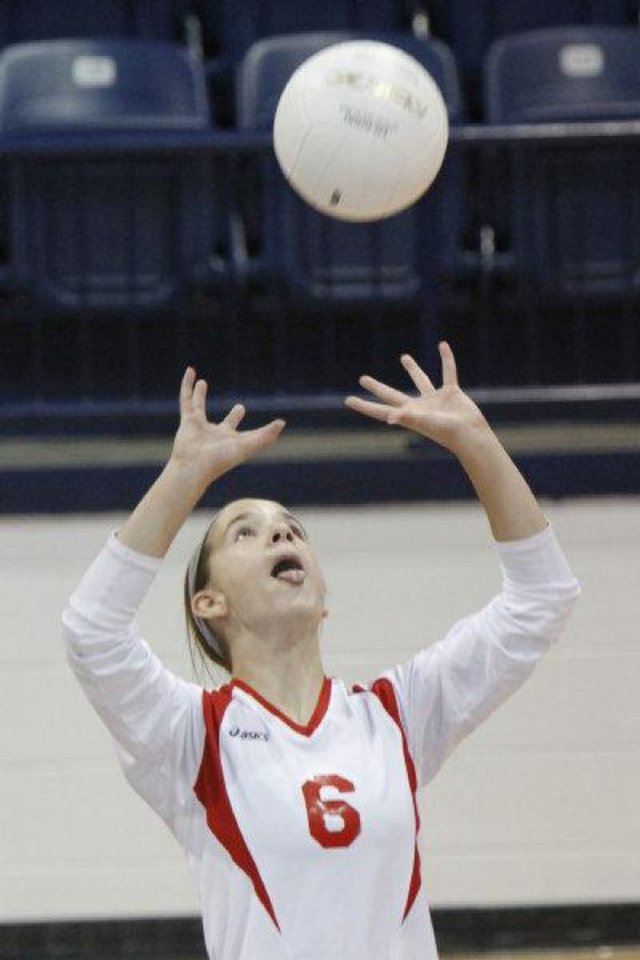 Photo - Oklahoma Christian's Emily Roberts sets up the ball for a teamate as they play against Cache in the Class 4A State Volleyball tournament at at Shawnee High School in Shawnee, OK, Friday, Oct. 7, 2011. By Paul Hellstern, The Oklahoman ORG XMIT: KOD