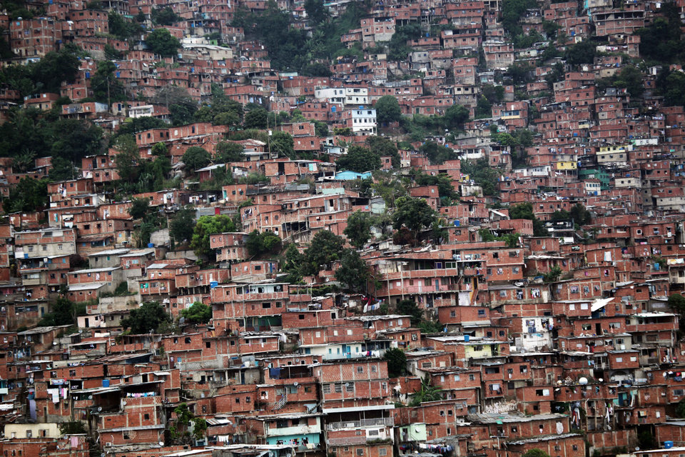 Homes cover a hill in the Petare neighborhood of Caracas, Venezuela, Friday, Oct. 5, 2012. The last time he ran for re-election, President Hugo Chavez won comfortably in Petare, one of Latin America's biggest slums with nearly half a million people. This time around, as Venezuelans vote Sunday, he may not. The neighborhood is divided, owing in some degree to mismanagement by pro-Chavez mayors and governors who were voted out of office in 2008 and 2010, respectively. (AP Photo/Rodrigo Abd)