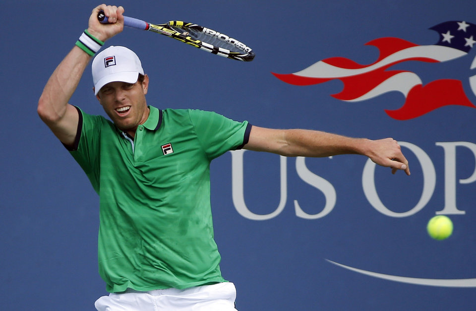 Photo - Sam Querrey, of the United States, returns a shot against Maximo Gonzalez, of Argentina, during the first round of the 2014 U.S. Open tennis tournament, Tuesday, Aug. 26, 2014, in New York. (AP Photo/Elise Amendola)