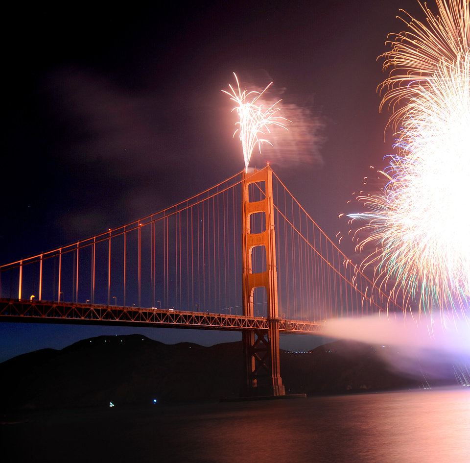 Photo -   Fireworks burst over the Golden Gate Bridge as part of the span's 75th anniversary celebration on Sunday, May 27, 2012, in San Francisco. (AP Photo/Noah Berger)