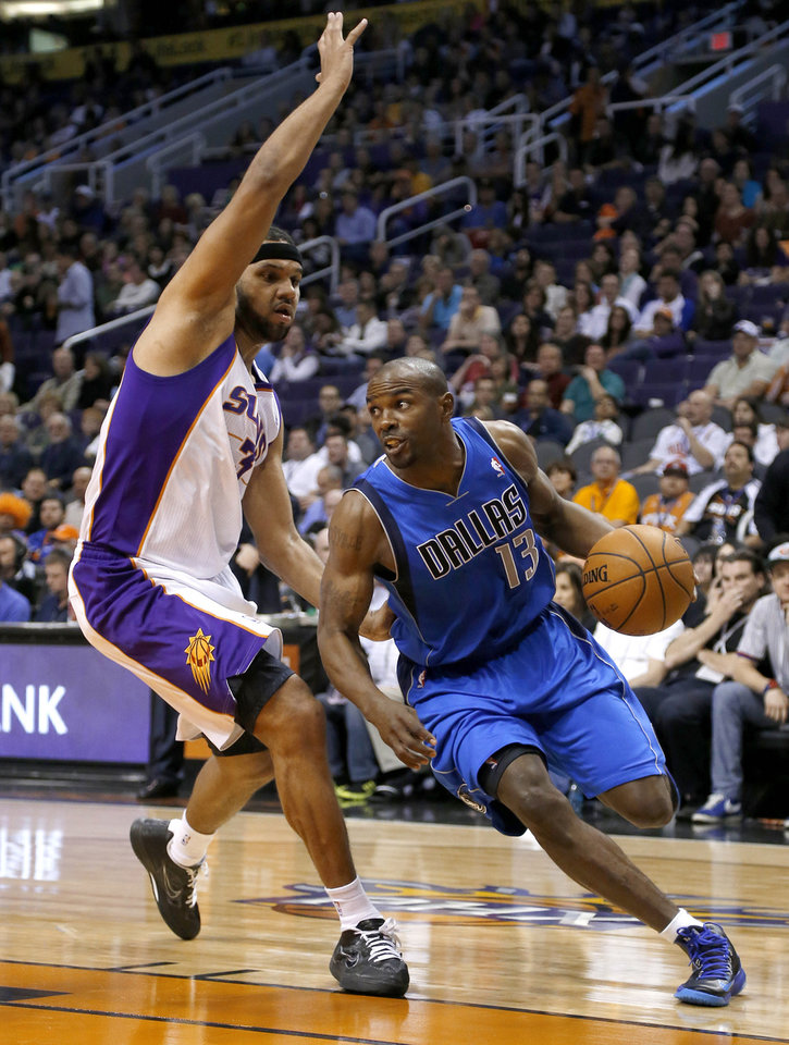 Dallas Mavericks' Mike James (13) drives past Phoenix Suns' Jared Dudley during the first half of an NBA basketball game Friday, Feb. 1, 2013, in Phoenix. (AP Photo/Matt York)