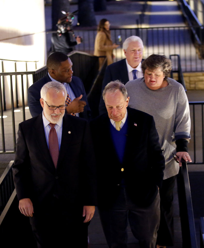 Photo - Democratic presidential candidate Mike Bloomberg walks with former governor Brad Henry with the Oklahoma City National Memorial & Museum before a campaign rally in Oklahoma City, Saturday, Feb. 8, 2020.  [Sarah Phipps/The Oklahoman]