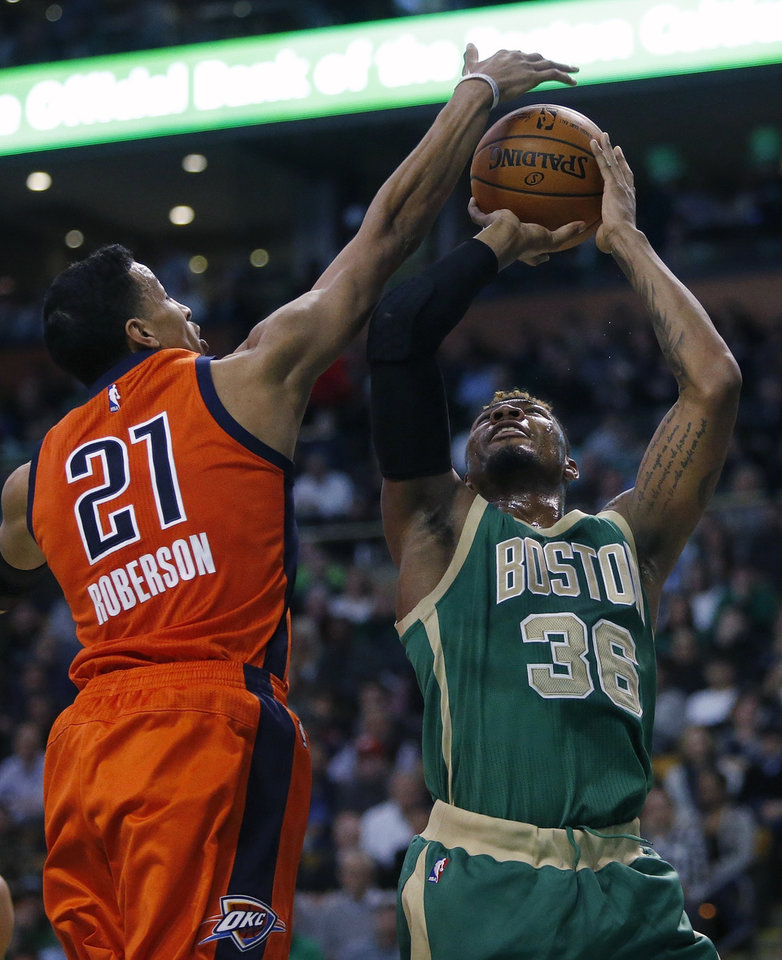 Photo - Oklahoma City Thunder's Andre Roberson (21) blocks a shot by Boston Celtics' Marcus Smart (36) during the first quarter of an NBA basketball game in Boston, Wednesday, March 16, 2016. (AP Photo/Michael Dwyer)