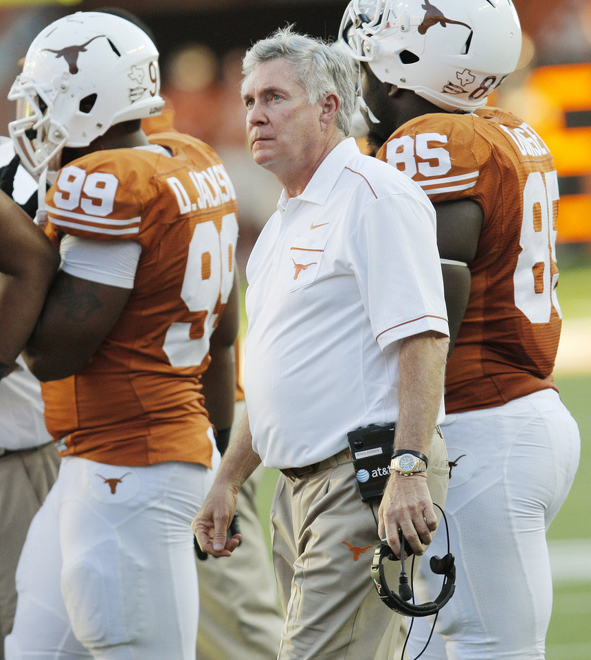 Photo - UT head coach Mack Brown walks on the field during a break in the action during a college football game between the Oklahoma State University Cowboys (OSU) and the University of Texas Longhorns (UT) at Darrell K Royal-Texas Memorial Stadium in Austin, Texas, Saturday, Oct. 15, 2011. OSU won, 38-26. Photo by Nate Billings, The Oklahoman