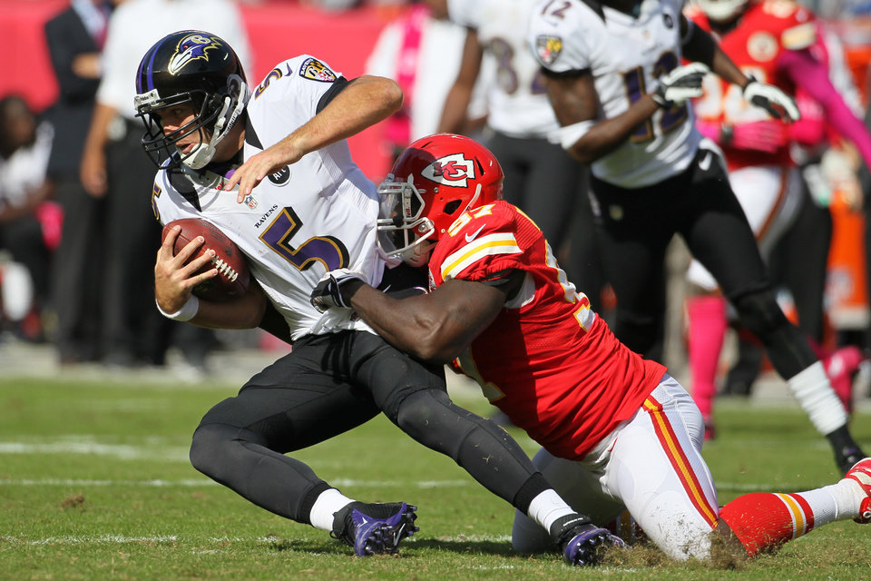 Photo -   Baltimore Ravens quarterback Joe Flacco (5) is sacked by Kansas City Chiefs defensive end Allen Bailey (97) during the 4th quarter of an NFL football game, Sunday, Oct. 7, 2012, in Kansas City, MO. (AP Photo/Colin E Braley)