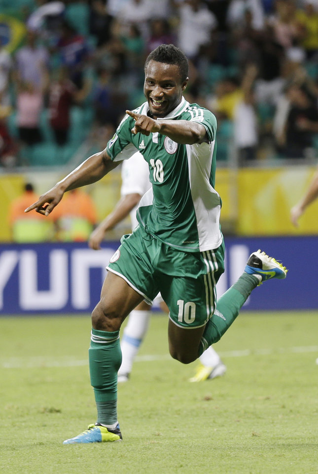 Photo - FILE - In this Vincent Enyeama, file photo, Nigeria's John Obi Mikel celebrates scoring his side's first goal during the soccer Confederations Cup group B match between Nigeria and Uruguay at Fonte Nova stadium in Salvador, Brazil. After impressing on their way to the second round in each of their first two FIFA World Cup appearances, 1994 and 1998, Nigeria have struggled since: going out at the group stage three times while taking just two points from their last eight matches in the finals. (AP Photo/Natacha Pisarenko,File)