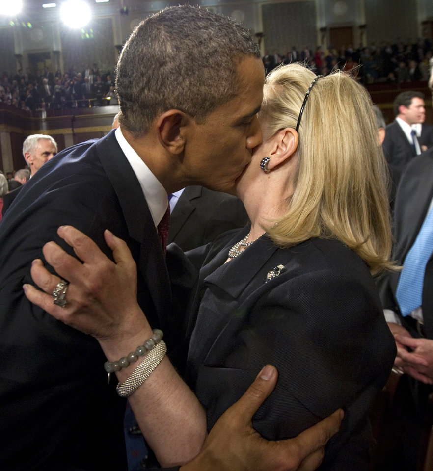 Photo - President Barack Obama kisses Secretary of State Hillary Clinton following his State of the Union address in front of a joint session of Congress Tuesday, Jan 24, 2012, at the Capitol in Washington. (AP Photo/Saul Loeb, Pool) ORG XMIT: WX176