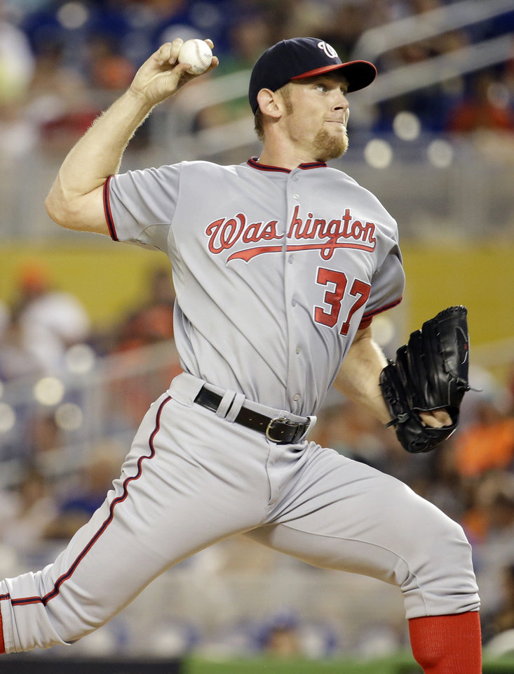 Photo - Washington Nationals starting pitcher Stephen Strasburg (37) throws in the first inning during a baseball game against the Miami Marlins, Tuesday, July 29, 2014, in Miami. (AP Photo/Lynne Sladky)