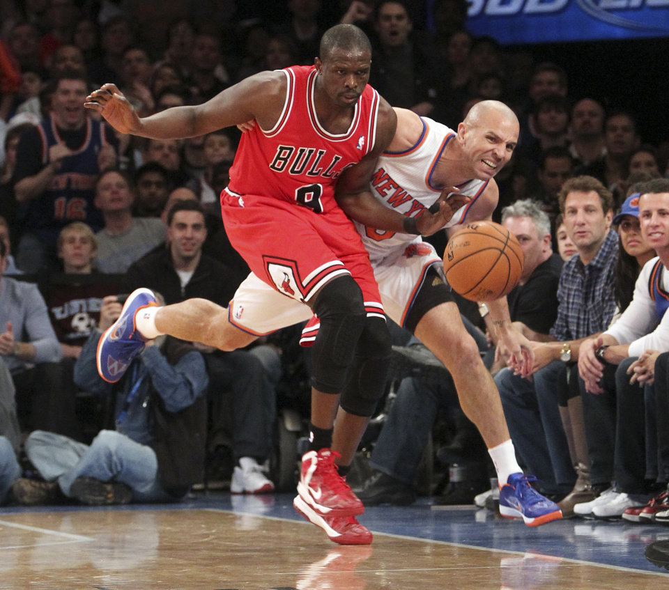 Photo - Chicago Bulls' Luol Deng, left, and New York Knicks' Jason Kidd chase a loose ball during the first half of  an NBA basketball game on Friday, Dec. 21, 2012, at Madison Square Garden in New York. (AP Photo/Mary Altaffer)