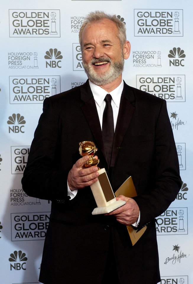 """FILE - In this Jan. 24, 2004 file photo, Bill Murray shows off his award for best actor in a musical or comedy for his work in """"Lost in Translation,"""" at the 61st Annual Golden Globe Awards in Beverly Hills, Calif. (AP Photo/Reed Saxon, File)"""