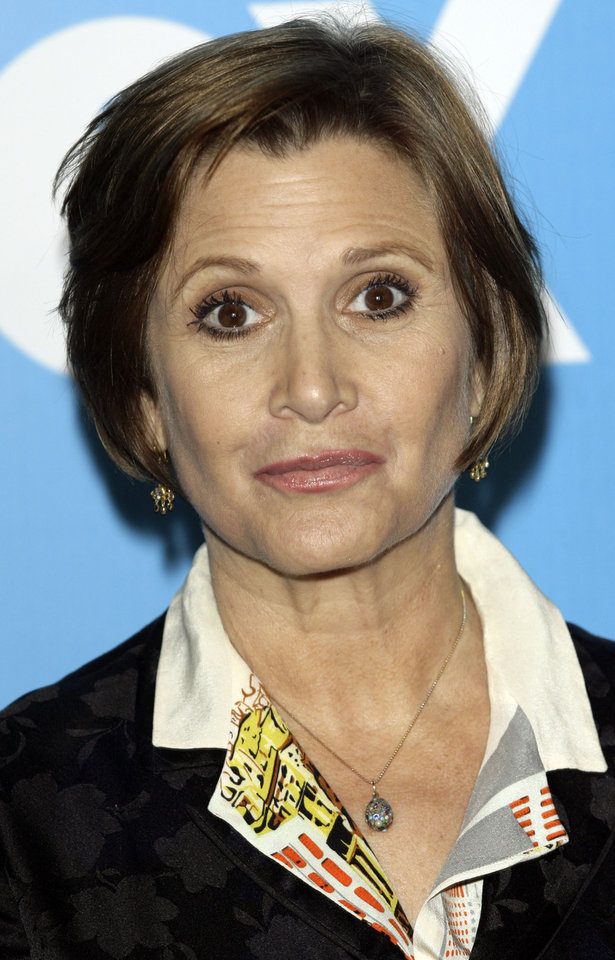 Photo - **FILE** This May 17, 2007 file photo shows Carrie Fisher arriving to the Fox 2007 programming presentation in New York. Fisher has written a 156-page memoir that she calls