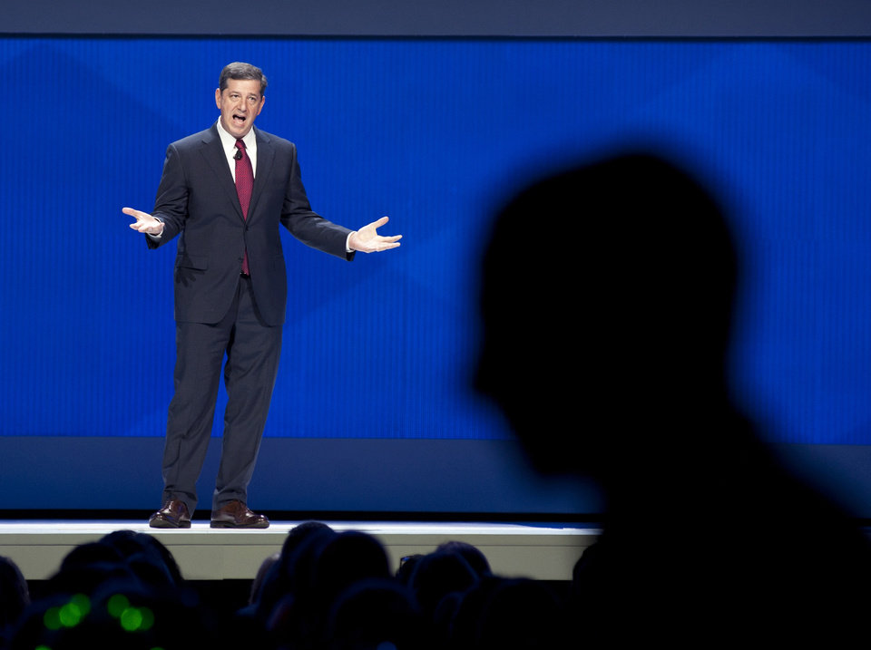 Photo - CORRECTS SIMON'S TITLE TO CEO OF WAL-MART U.S. INSTEAD OF WAL-MART - Bill Simon, President and CEO of Wal-Mart U.S., speaks during the annual Wal-Mart Shareholders meeting in Fayetteville, Ark., Friday June 6, 2014. The annual Wal-Mart shareholder's meeting drew about 14,000 people, including its workers from around the globe. (AP Photo/Sarah Bentham)