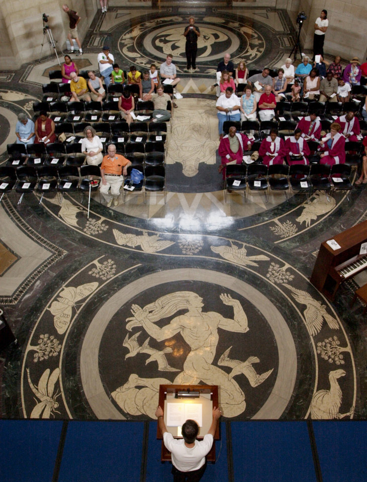 "Photo - FILE -  This Aug. 23, 2003 file photo shows Nebraska Gov. Mike Johanns, bottom, addresses a gathering in the rotunda of the State Capitol in Lincoln featuring the floor decorated with the design of Art Deco muralist Hildreth Meiere. While Meiere's name has been largely forgotten her works abound throughout the country. ""The Art Deco Murals of Hildreth Meiere,"" by Catherine Coleman Brawer and Kathleen Murphy Skolnik with photographs by Meiere's granddaughter, Hildreth Meiere Dunn, is set for release May 1. (AP Photo/Nati Harnik, File)"