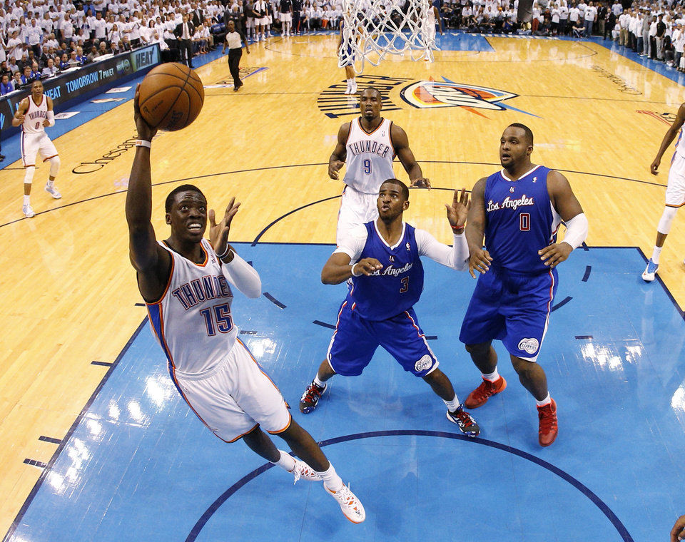 Photo - Oklahoma City's Reggie Jackson (15) goes to the basket beside Los Angeles' Chris Paul (3) during Game 5 of the Western Conference semifinals in the NBA playoffs between the Oklahoma City Thunder and the Los Angeles Clippers at Chesapeake Energy Arena in Oklahoma City, Wednesday, May 14, 2014. Photo by Bryan Terry, The Oklahoman