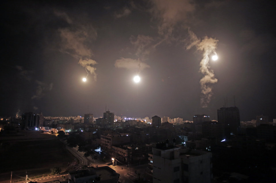 Photo - Israeli forces' flares light up the night sky of Gaza City on early Tuesday, July 29, 2014. A truce between Israel and Hamas militants in Gaza remained elusive as diplomats sought to end the fighting at the start of the Eid al-Fitr holiday, marking the end of the Muslim holy month of Ramadan. (AP Photo/Khalil Hamra)