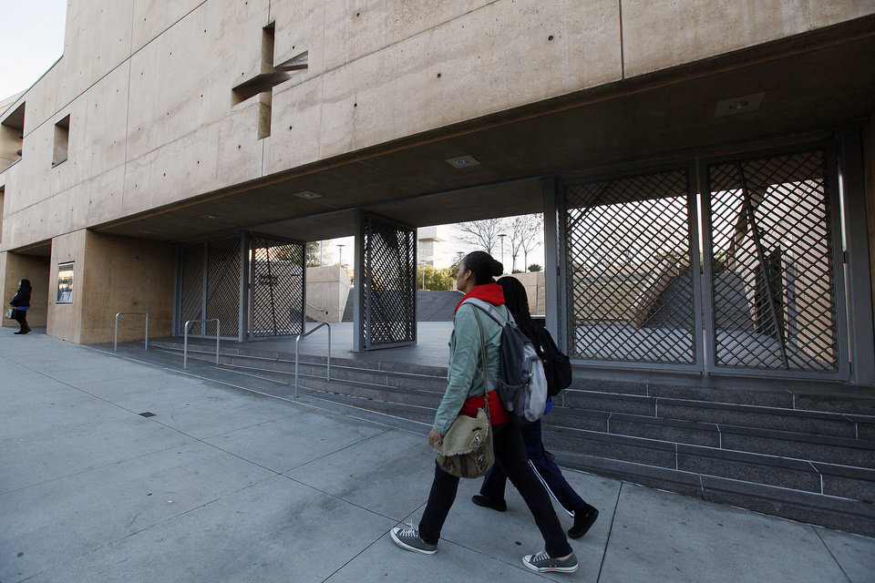 Photo - Students walk past the Cathedral Of Our Lady Of Angels the seat of the Archdiocese of Los Angeles on Friday Feb. 1,2013 . Cardinal Roger Mahony, who retired with a tainted career after dodging criminal charges over how he handled pedophile priests, was stripped of duties by his successor as a judge ordered confidential church personnel files released. (AP Photo/Nick Ut)
