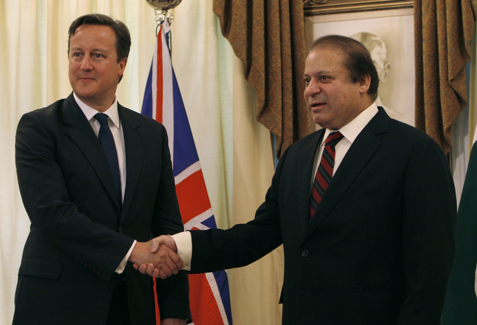 Photo - British Prime Minister David Cameron, left, shakes hand with his Pakistani counterpart Nawaz Sharif prior to their meeting in Islamabad, Pakistan, Sunday, June 30, 2013. Cameron is in Islamabad on a tow-day visit to hold talks with Pakistani top leaders on bilateral interest, regional and international importance including the peace process in Afghanistan. (AP Photo/Anjum Naveed)