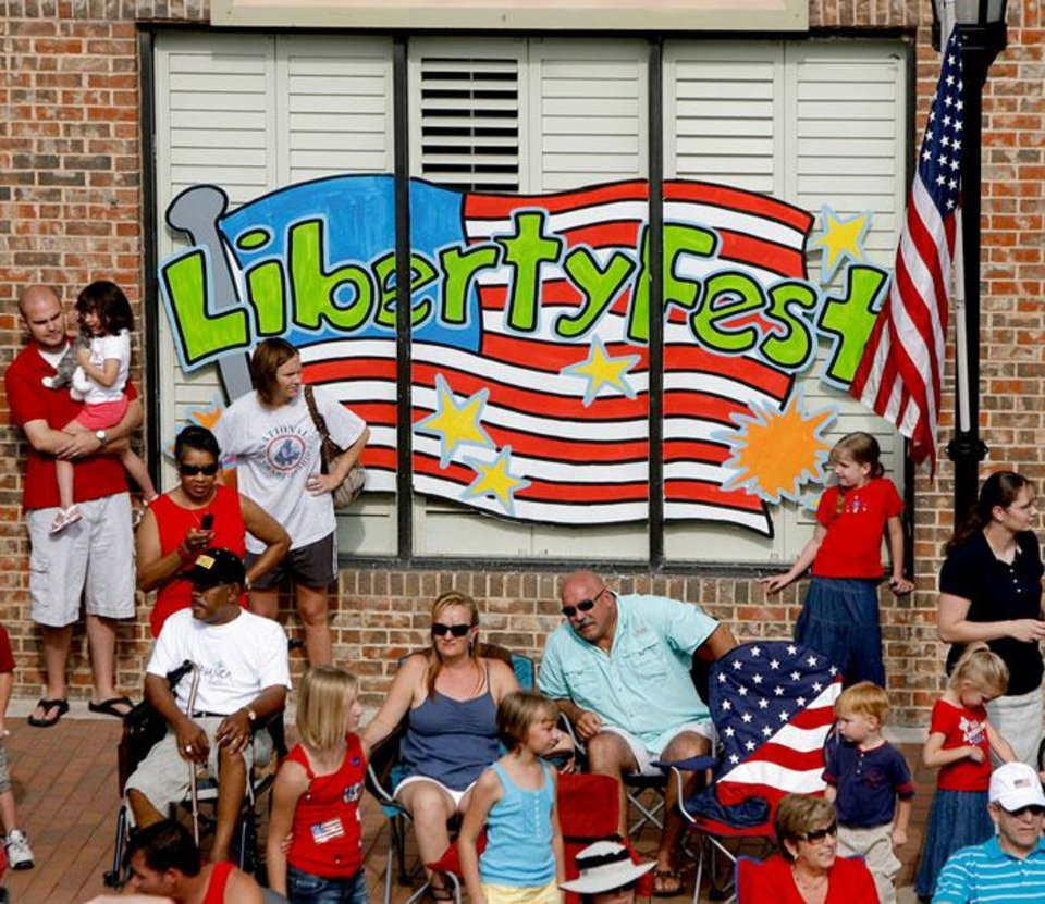 Photo -  People watch the LibertyFest Parade on Broadway in Edmond, Okla., during the Saturday, July 4, 2009. Photo by Bryan Terry, The Oklahoman
