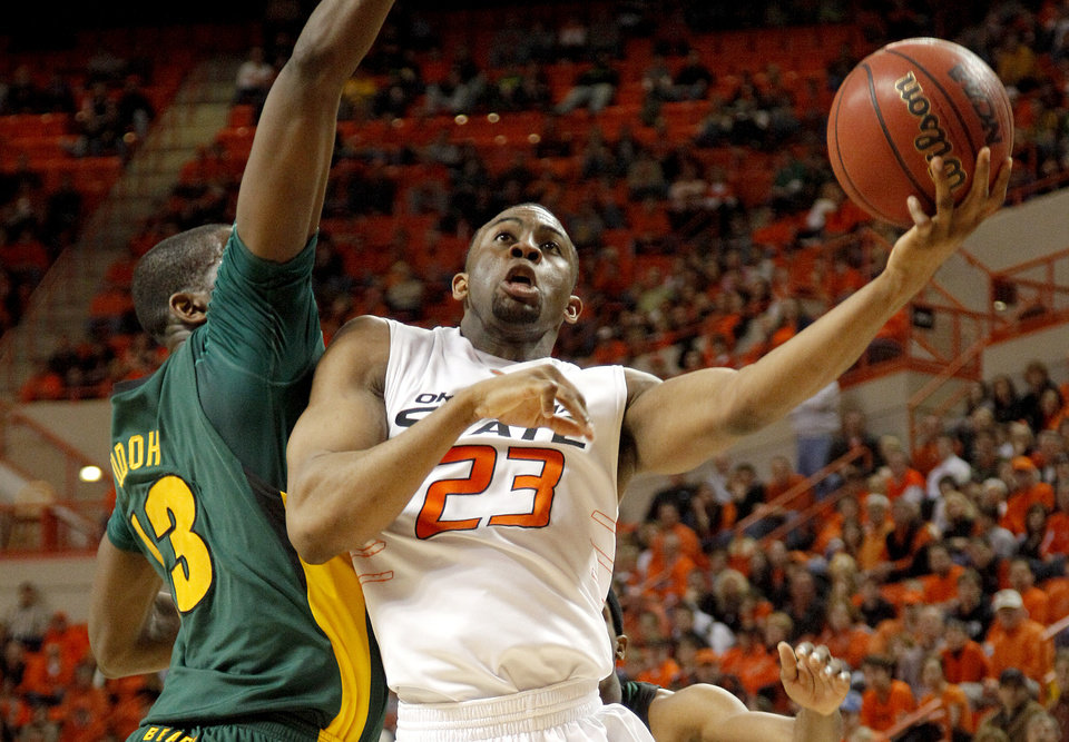 Photo - OSU's James Anderson goes past Baylor's Ekpe Udoh during an NCAA college basketball game between Oklahoma State University and Baylor at Gallagher-Iba Arena in Stillwater, Okla., Saturday, Feb. 20, 2010.  Photo by Bryan Terry, The Oklahoman ORG XMIT: KOD