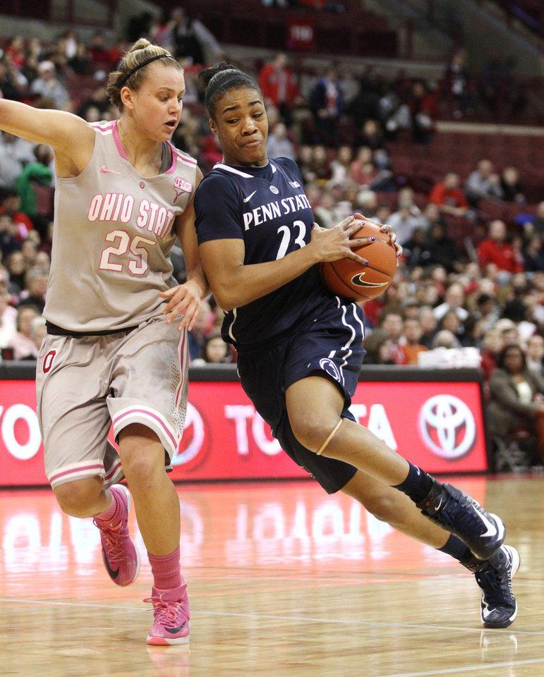 Photo - Ohio State's Amy Scullion (25) tries to slow down Penn State's Ariel Edwards (23) during the first half of an NCAA college basketball game on Sunday, Feb. 9, 2014, in Columbus, Ohio. (AP Photo/Mike Munden)