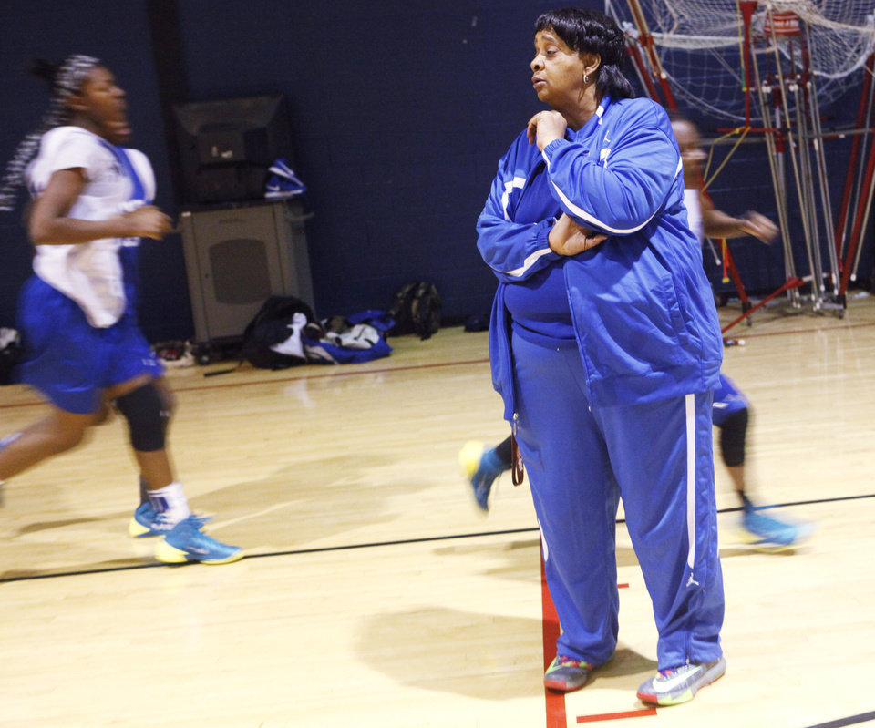 Photo - Millwood basketball coach Arnelia Spears walks across the court as players run laps during practice on Tuesday, March 11, 2014. Spears is retiring from coaching after over 40 years at Millwood. Photo by KT King, The Oklahoman