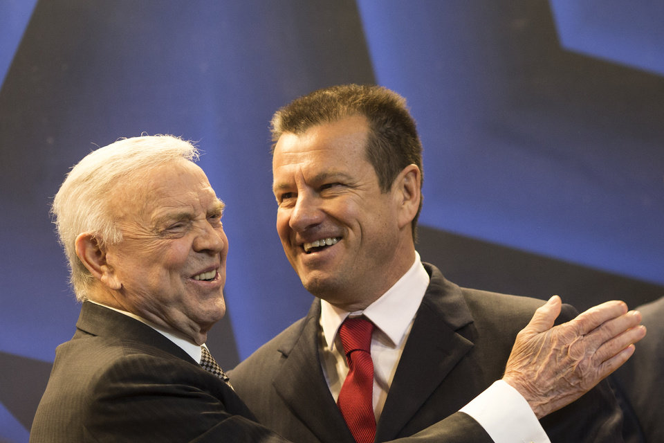 Photo - Brazil soccer coach Dunga, right, is embraced by Brazilian Soccer Confederation President Jose Maria Marin, after a press conference announcing Dunga as the new head coach of the Brazilian national team, in Rio de Janeiro, Brazil, Tuesday, July 22, 2014. Dunga returned to the post replacing Luiz Felipe Scolari, who resigned after Brazil failed to win the 2014 World Cup eliminated in a 7-1 loss to Germany in the semifinals. (AP Photo/Felipe Dana)