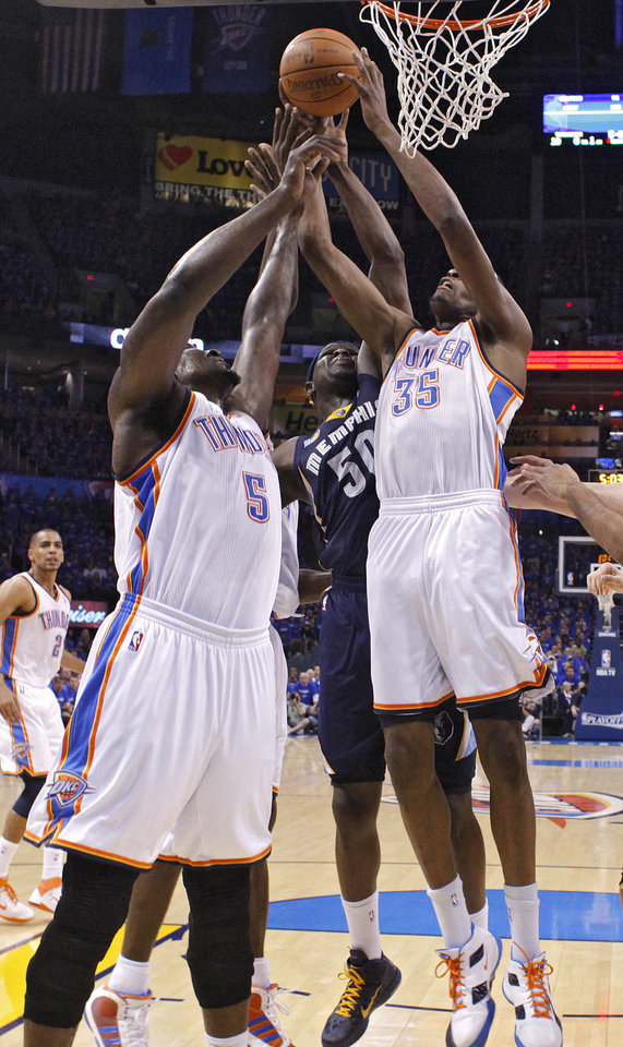 Photo - Oklahoma City's Kendrick Perkins (5) and Oklahoma City's Kevin Durant (35) fight for a rebound with Zach Randolph (50) of Memphis during game two of the Western Conference semifinals between the Memphis Grizzlies and the Oklahoma City Thunder in the NBA basketball playoffs at Oklahoma City Arena in Oklahoma City, Tuesday, May 3, 2011. Photo by Chris Landsberger, The Oklahoman