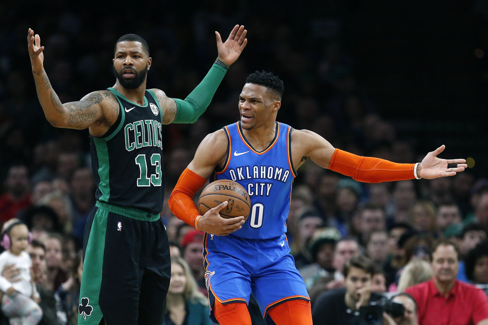 Photo - Oklahoma City Thunder's Russell Westbrook (0) protests a call beside Boston Celtics' Marcus Morris (13) during the first half of an NBA basketball game in Boston, Sunday, Feb. 3, 2019. (AP Photo/Michael Dwyer)