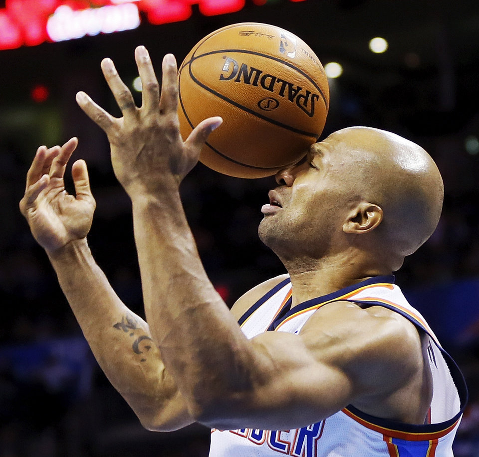 Oklahoma City's Derek Fisher (6) is hit in the face with the ball during a preseason NBA basketball game between the Oklahoma City Thunder and the Utah Jazz at Chesapeake Energy Arena in Oklahoma City, Sunday, Oct. 20, 2013. Oklahoma City won, 88-82. Photo by Nate Billings, The Oklahoman