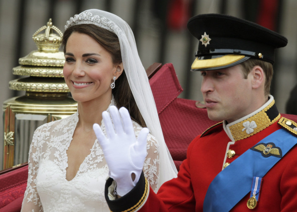 Photo - Britain's Prince William and his wife Kate, Duchess of Cambridge wave as they leave Westminster Abbey at the Royal Wedding in London Friday, April  29, 2011. (AP Photo/Gero Breloer)  ORG XMIT: RWFO145