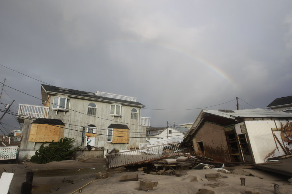 Photo -   Damage from flooding at Breezy Point after superstorm Sandy Tuesday, Oct. 30, 2012, in the New York City borough of Queens.The fire destroyed between 80 and 100 houses Monday night in the flooded neighborhood. (AP Photo/Frank Franklin II)
