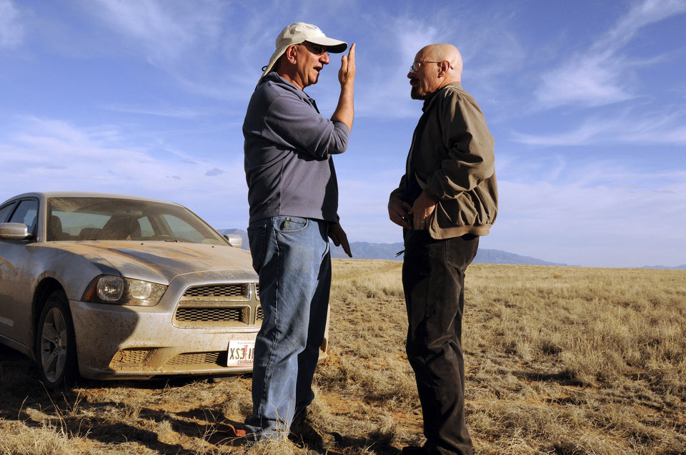 Photo - This 2012 photo released by AMC shows cinematographer Michael Slovis, left, and Bryan Cranston on the set of