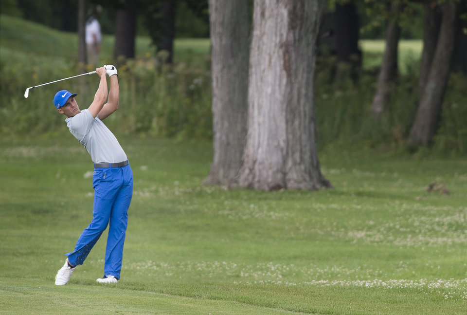 Photo - Jamie Lovemark, from the United States, plays a shot from the 18th fairway during the third round of the Canadian Open golf championship at the Royal Montreal Golf Club in Montreal, Saturday, July 26, 2014. (AP Photo/The Canadian Press, Graham Hughes)