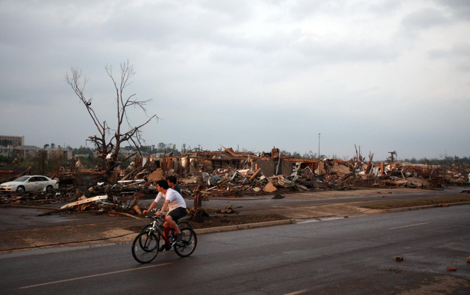 Photo - Homes and businesses are completely destroyed along 15th St. in Tuscaloosa, Ala. Wednesday, April 27, 2011. A wave of severe storms laced with tornadoes strafed the South on Wednesday, killing at least 16 people around the region and splintering buildings across swaths of an Alabama university town. (AP Photo/The Tuscaloosa News, Dusty Compton)